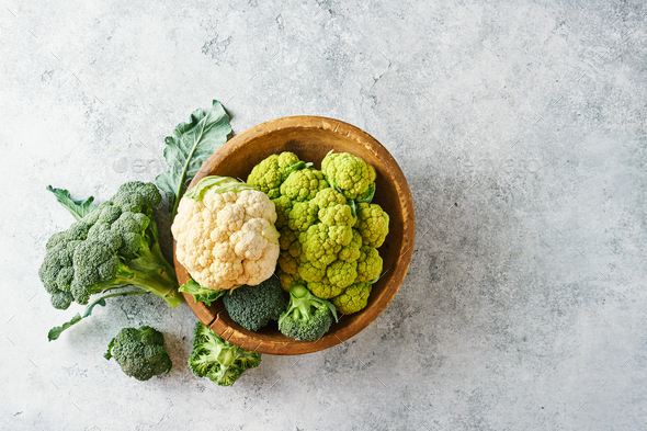 Fresh cabbage broccoli and cauliflower in a wooden bowl - Stock Photo - Images