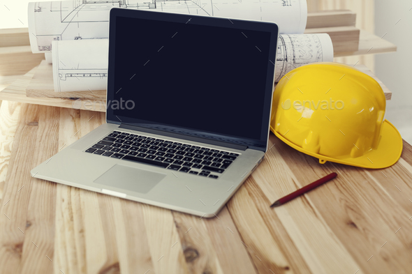 Close up of laptop on workplace for construction worker - Stock Photo - Images