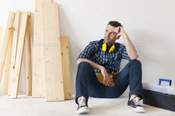 Carpenter relaxing after work - Stock Photo - Images