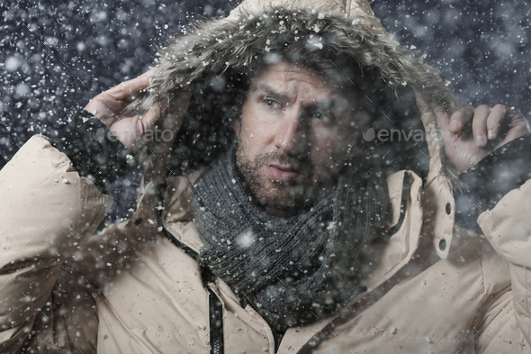 Handsome man in snow storm - Stock Photo - Images