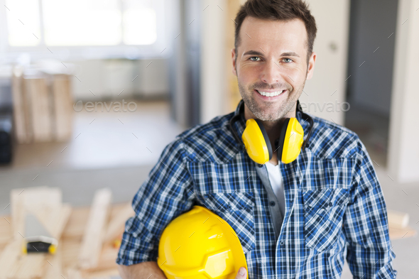 Portrait of smiling construction worker - Stock Photo - Images