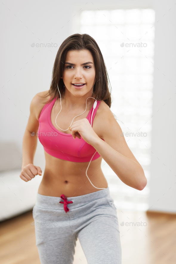 Woman during the cardio training at home - Stock Photo - Images
