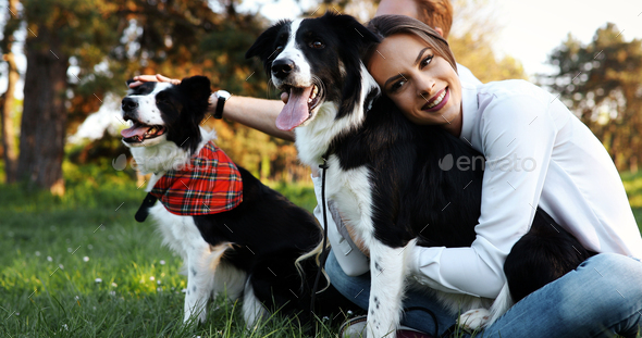 Beautiful woman walking cute dog in nature - Stock Photo - Images
