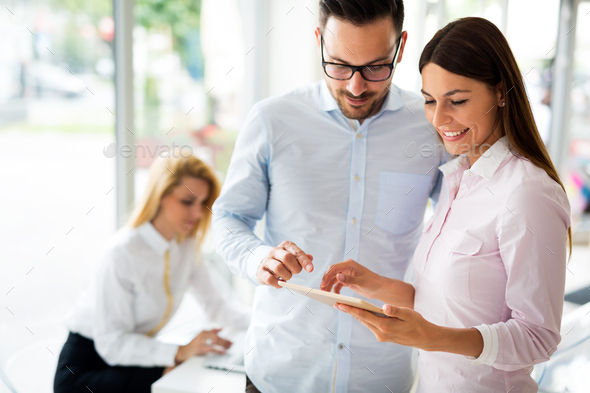 Happy colleagues casual chat at the office - Stock Photo - Images
