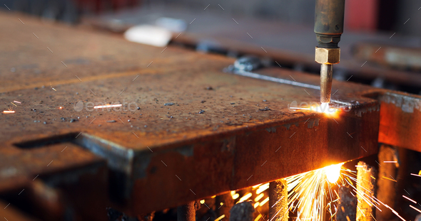Oxygen torch cuts steel sheet. CNC gas cutting machine. Bright sparks - Stock Photo - Images