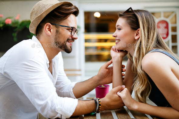 Summer holidays, dating, love and tourism concept. Smiling couple in the city - Stock Photo - Images