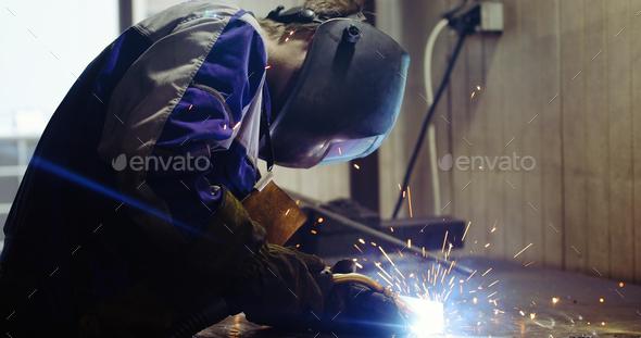 Metal worker welding in metal industry factory - Stock Photo - Images