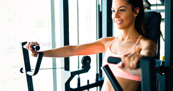 Beautiful woman doing chest exercises - Stock Photo - Images