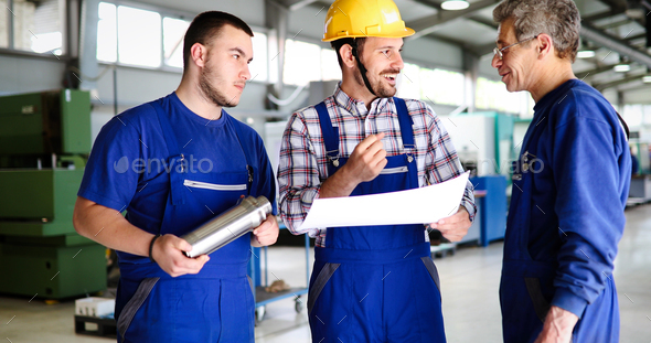 Portrait of an handsome engineer in a factory - Stock Photo - Images