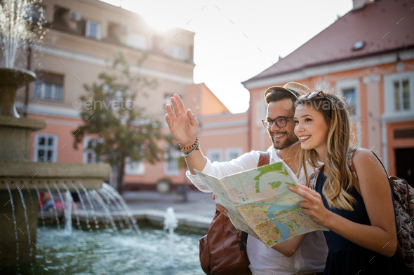 Happy tourist couple in love having fun, travel, smiling on vacation - Stock Photo - Images