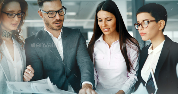 Group of business people collaborating in office - Stock Photo - Images
