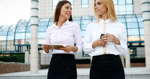 Picture of two young beautiful women as business partners - Stock Photo - Images