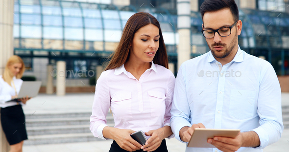 Happy business colleagues in modern office - Stock Photo - Images