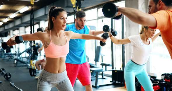Beautiful women working out in gym - Stock Photo - Images