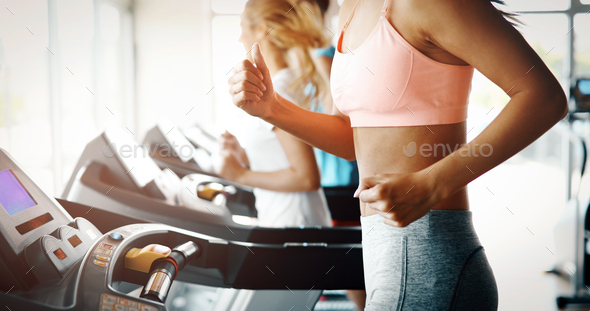Picture of people running on treadmill in gym - Stock Photo - Images