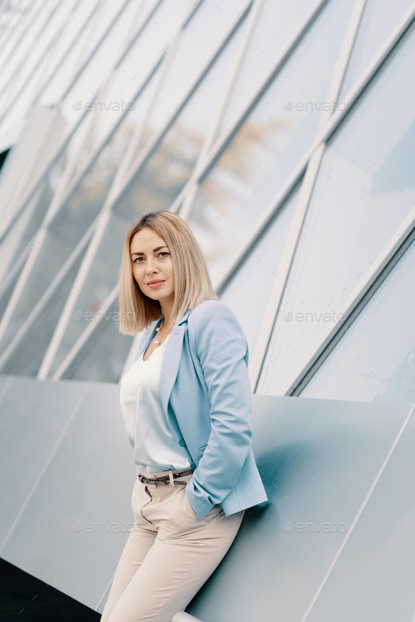 Successful business woman in blue suit - Stock Photo - Images