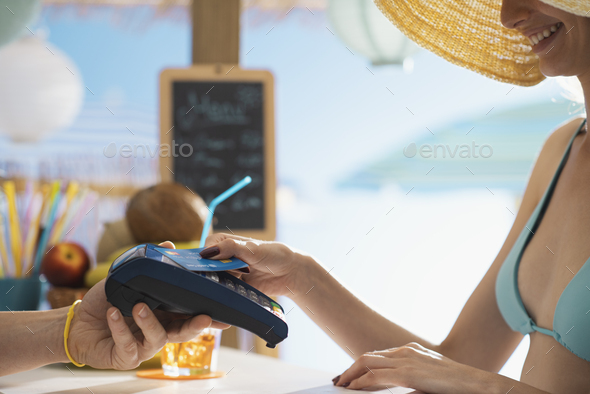 Woman paying using a contactless credit card - Stock Photo - Images