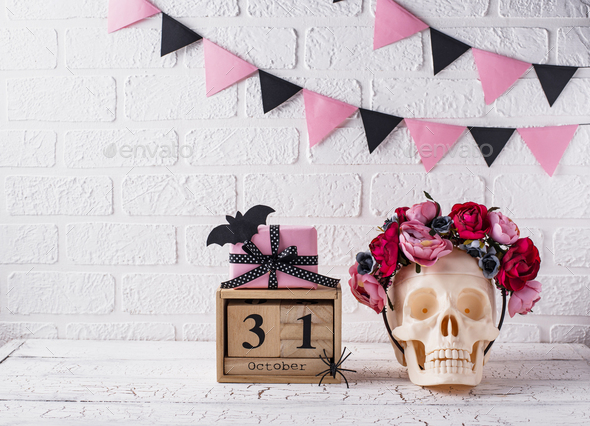 Skull with wreath of pink flowers - Stock Photo - Images