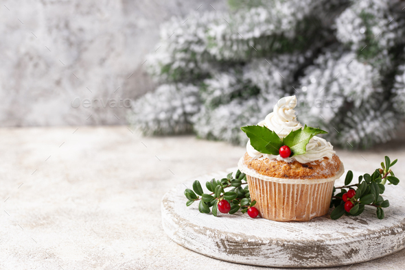 Christmas festive cupcake with holly leaves - Stock Photo - Images