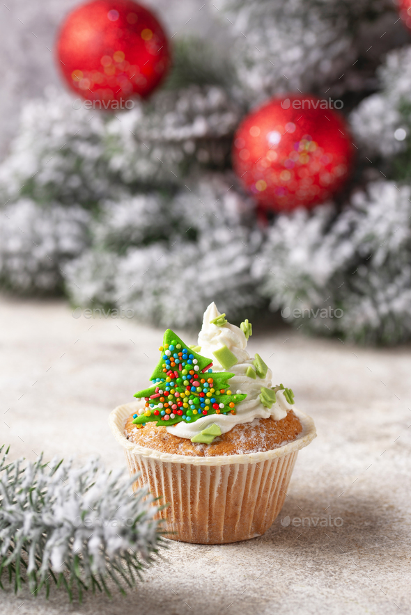 Christmas festive cupcake with cream - Stock Photo - Images
