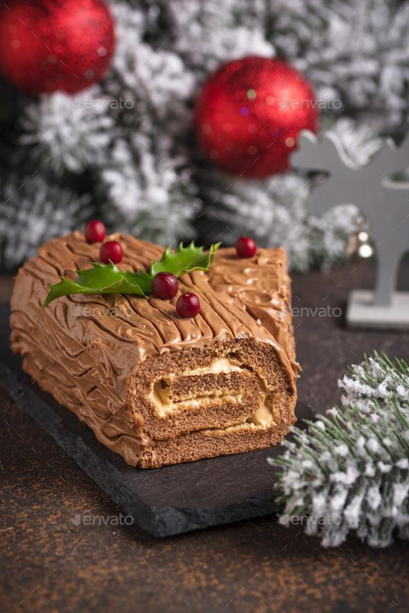 Christmas yule log cake. Traditional chocolate dessert - Stock Photo - Images