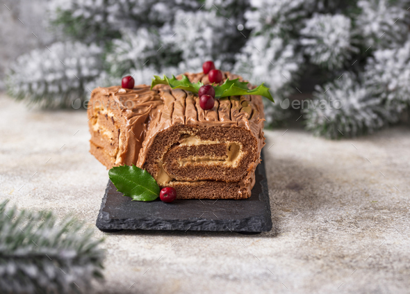 Christmas yule log cake. Traditional chocolate dessert - Stock Photo - Images