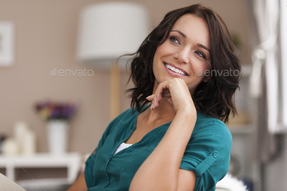 She looks relaxed in her home - Stock Photo - Images