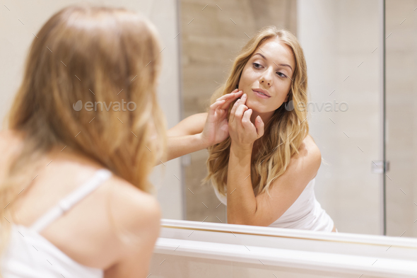 Blonde woman has problems with skin on the face - Stock Photo - Images