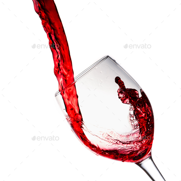 Red Wine Pouring into a Glass - Stock Photo - Images