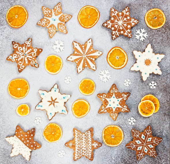 Christmas ginger cookies in the shape snowflakes and dried orange - Stock Photo - Images