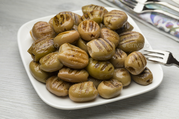 Dish with grilled green olives - Stock Photo - Images