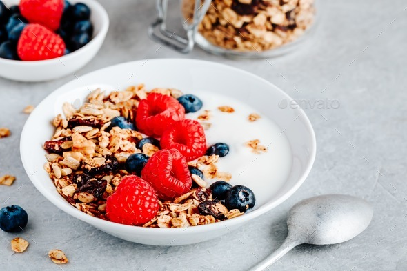 Healthy breakfast bowl homemade granola with fresh blueberry and raspberry - Stock Photo - Images