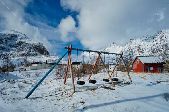 Children playground in winter. A village, Lofoten islands, Norway - Stock Photo - Images