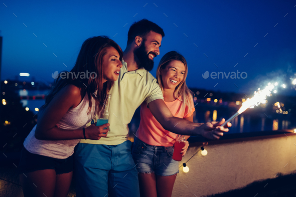 Group of happy friends celebrating at rooftop - Stock Photo - Images
