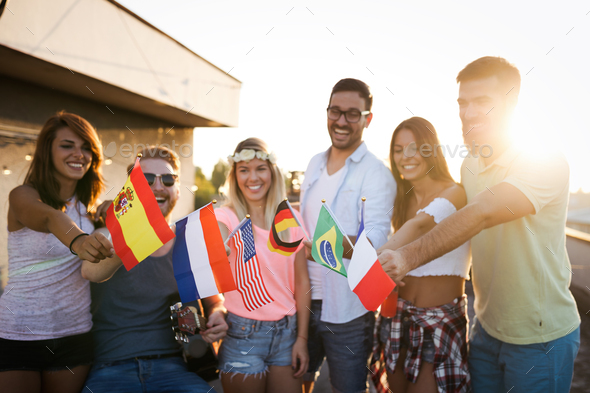 Group of happy friends having party on rooftop - Stock Photo - Images
