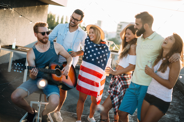 Group of carefree friends dancing have fun in summer - Stock Photo - Images