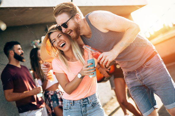 Happy couple having fun time at party - Stock Photo - Images