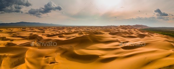 Sunset over the sand dunes in the desert - Stock Photo - Images