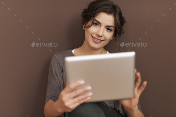 Beautiful woman with contemporary digital tablet - Stock Photo - Images