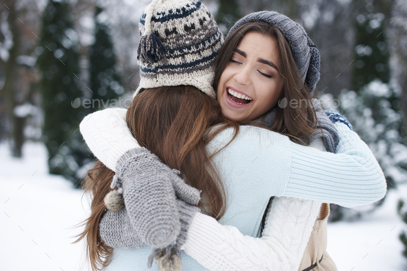 Winter hugs of the best friends - Stock Photo - Images