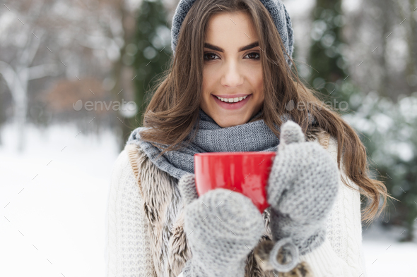 Winter woman with cup of hot tea - Stock Photo - Images