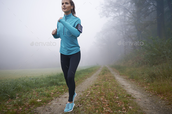 She find path perfect for morning run - Stock Photo - Images