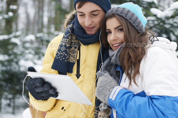 Listening to music from digital tablet - Stock Photo - Images