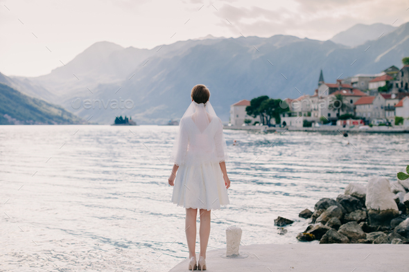 bride walking in picturesque bay - Stock Photo - Images