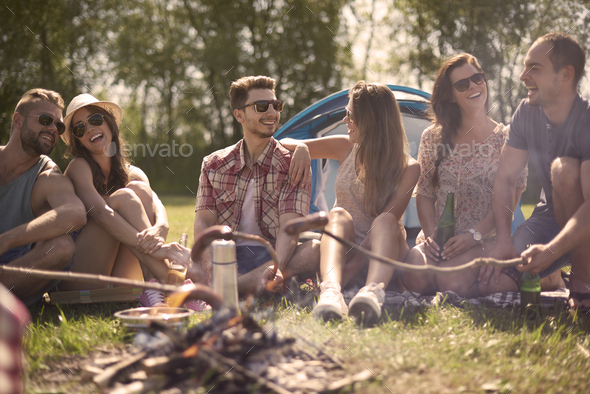 Camping by the lake with good friends - Stock Photo - Images