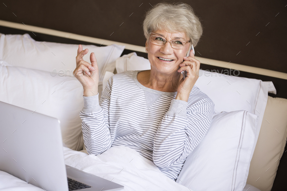 The most comfortable place for working is my bed - Stock Photo - Images