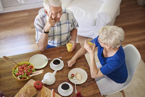 Elder couple eating breakfast together - Stock Photo - Images
