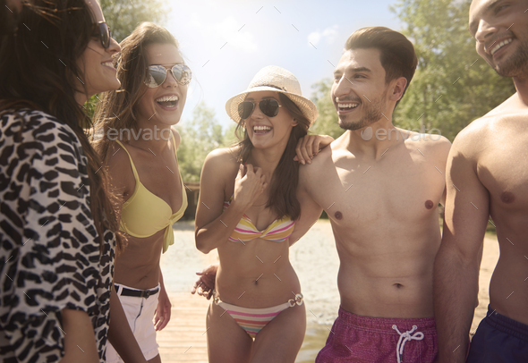 Group of friends on the lake - Stock Photo - Images