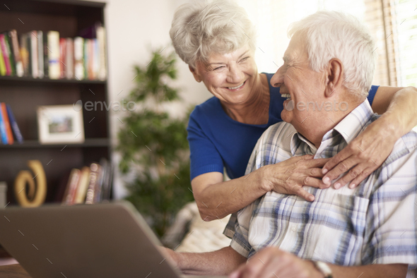 Senior marriage using laptop in the living room - Stock Photo - Images