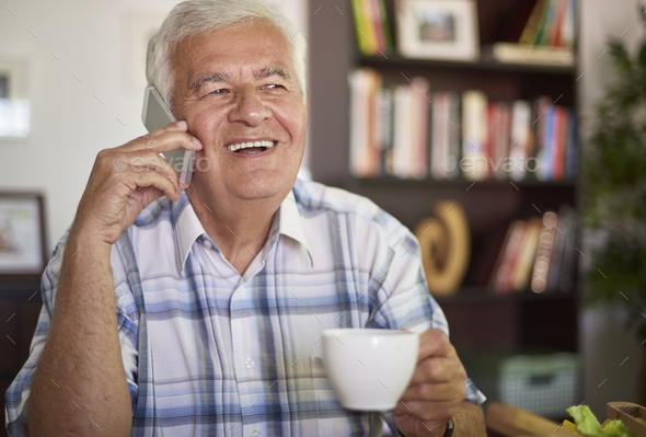 Senior man talking on his mobile phone - Stock Photo - Images